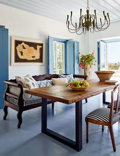 the blue and white dining room in this greek island home is balanced by warm wood antiques | house tour via coco kelley