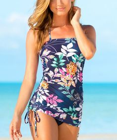 Catch some rays and eyes at the beach in this tankini top accented by a floral design that brings vivid color to your ocean-loving ensemble.