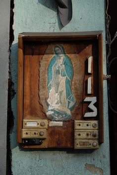 Guadalupe 113    The Virgen de Guadalupe protects door bells in Mexico City