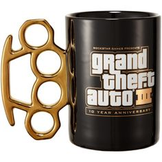 "GTAIII Anniversary Knuckleduster Mug $20.00  To commemorate the game's 10th anniversary, Rockstar Games presents the special anniversary edition Knuckleduster Mug. The Grand Theft Auto III Ten Year Anniversary Knuckleduster Mug features: a ""brass knuckle"" handle that is electroplated with Titanium, a Grand Theft Auto Ten Year Anniversary logo that is printed with white ink and real 18kt gold, and a white Rockstar logo printed on its base."
