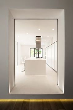 light kitchen by Carola Vannini. Forget the kitchen I like the thick doorway....