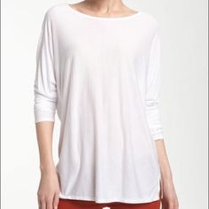 "Vince White Dolman Lightweight Tunic Tee Large NWT Vince Dolman Tunic Tee in White. Lightweight swaths join at the center back seam of an oversized boat-neck top with both relaxed and sophisticated styling potential.  Side slits.  Approx. length from shoulder: 27"".  Viscose rayon.  Large NWT Vince Tops Blouses"