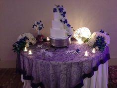 The sea stars give this wedding cake display a fun beach feel! #Wedding #Reception