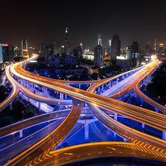 Nine Dragon Pillar intersection in Shanghai, blue lights are installed underneath the overpass Rush Hour by Mathijs van den Bosch on Canon Eos, Shanghai Skyline, Destinations, Rush Hour, Exposure Photography, City Photography, Destination Voyage, Antoni Gaudi, Las Vegas Strip