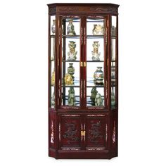 Rosewood Dragon Motif Corner Curio Cabinet.  Our solid rosewood corner curio cabinet is ideal to make the corner in your home useful and decorated. Relief dragon motif and mother of pearl inlaid flowers decorate the entire cabinet. Three adjustable glass shelves, mirrored back and halogen lights inside to display your treasured collectibles. Hand applied rich dark cherry finish. Curio display cabinet.