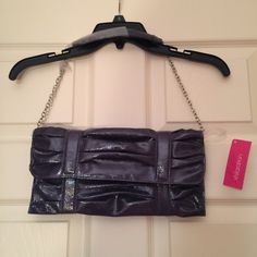 Xhilaration Clutch Dark Purple Clutch from Xhilaration. Never used with original tags. Plastic straps still attached to protect shoulder straps. Originally paid $20, selling for $8 Xhilaration Bags Shoulder Bags