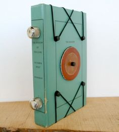 Pinhole camera is constructed from a vintage hardback book.