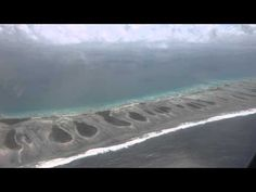 Aerial view of the Rangiroa atoll. Video by Paul C. Szigety