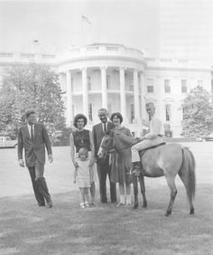 The Kennedys with Lyndon Johnson and his daughter Lynda Bird and Macaroni, the pony.