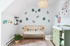 Cute nursery with a nice touch of color. Decorated by Buk&Nola.