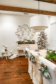 Dining Room - Christmas Home Tour 2020 - Farmhouse Living - Slipcovered Chairs - 14ft Dining Table - Rejuvenation Conical Drum Pendants - Modern Farmhouse Christmas - Large Dining Room - Dough Bowl Centerpiece - White Piano - Plate Wall - Platers on Wall