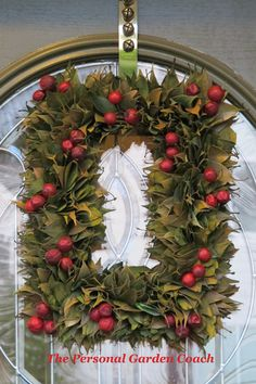 Simple Holiday wreath with rose Hips and Salal. Would love to do this around a mirror or picture frame.