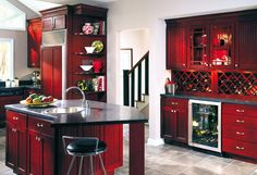 Red kitchen cabinets, black counters. Great wine bar area