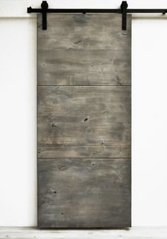 The Modern Slab barn door, featuring large slab panels of solid wood, expresses a minimalist modern appearance. This design is well suited for modern, contemporary, or mid-century settings. All Dogber Sliding Barn Door Hardware, Sliding Doors, Front Doors, Door Hinges, Barn Door In House, Traditional Doors, Door Makeover, Bathroom Doors, Bathrooms