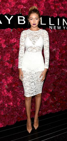 Celebrity Style at NYFW Spring 2016 - Gigi Hadid in a sheer white lace dress, nude pointy-toe pumps, and vampy dark red lipstick | @StyleCaster