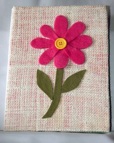 A simple composition book covered with burlap and a big flower.