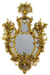 "Chippendale Rococo Mirror, 1762. Fine rococo carving, with flowers, leaves, bullrushes and birds.  The name of Thomas Chippendale stands most closely associated with English rococo style furniture. In the middle of the eighteenth century Chippendale published his ""Gentleman's and Cabinet Makers Director"" which cemented the rococo style of interior display in England."