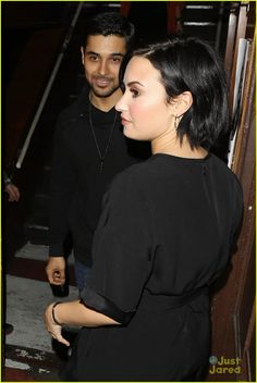 Demi Lovato keeps close to boyfriend Wilmer Valderrama as they leave the back entrance to the Troubadour in Los Angeles on Wednesday night