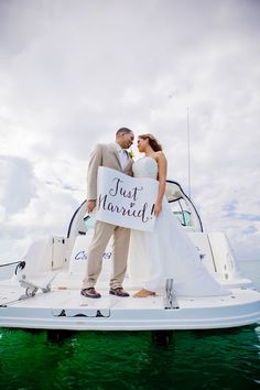 "Holding a ""Just Married"" sign is really cute!    Destination Weddings in Grand Cayman"