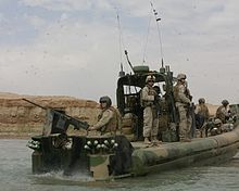 What Dave does! -United States Navy Riverine Warfare.  Armed to the hilt...be afraid enemies, be very afraid.  Hooyah!