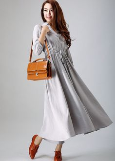 This delightful grey shirt dress craft with soft linen fabric, finished with V neckline , Gathered three quarter sleeve, The drawstring Waist make a fit and flare silhouette . Wear this linen midi dress for your casual weekend.  6 Gorgeous more Color Available https://www.etsy.com/treasury/Nzc2ODUxMnwyNzI4MzY0MTA0  DETAIL * Soft linen * Button front closure * 3/4 sleeve * Drawsting wasit * pockets at side * Length approx 122 cm * Wash by hand or machine with cold water * you can choose any…