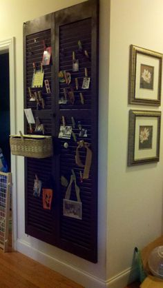 Louvered closet door painted. Hang basket with shower curtain hooks.  Decorated clothes pins.