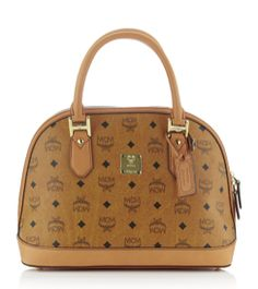 MCM.. My new favorite handbag designer. Gives off something a little different rather than using gucci and LV...