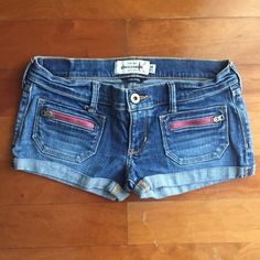 "FINAL REDUCTION Junior Size Blue Jean Shorts || 14 Blue jean shorts with pink detail.  •Condition: Good! Has an initial ""K"" from previous owner (one of my friends.) •Brand: Abercrombie kids  •Size: 14 (fits most like adult 00)  ♡Shipping 1-2 business days✨ ♡Smoke-free closet ♡No trades ♡Make offers using the offer button only (Price will not be negotiated through comments) ♡Bundle! 10% for two or more items! ♡Comment if you have any questions! Abercrombie & Fitch Shorts Jean Shorts"