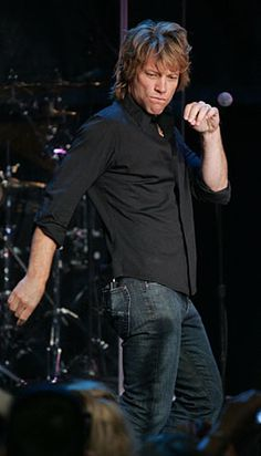 "Jon Bon Jovi shows off his stage moves during WPLJ-FM's ""Sweet 16"" anniversary concert Wednesday in New York."