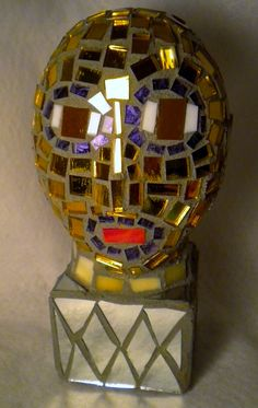 recycled stained glass mosaic on found form
