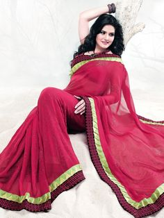 Be a stylish diva in a red soothing color very light weight soft georgette saree.  The drape is printed in floral pattern , resham and patch work.  matching blouse material comes with this saree which can be custom made. Special Price: $115.00