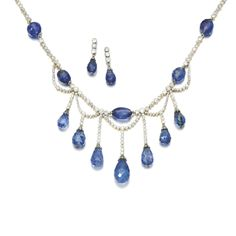 Sapphire and diamond demi-parure Comprising: a necklace designed as a fringe of millegrain-set circular-cut diamonds, accented with faceted sapphires; and a pair of pendent earrings, en suite.