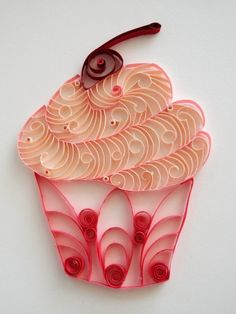 This adorable, paper-crafted cupcake is such fun, whether you hang it in your a kitchen or a little girl's room.