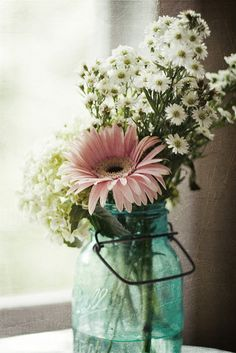 I like the pink gerber daisy combined with the white wildflowers