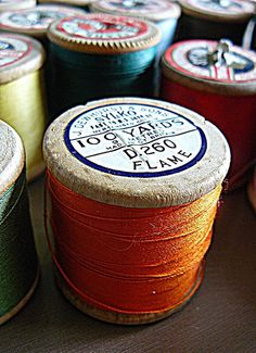 vintage threads on wooden spools by Corset Laced Mannequins, via Flickr