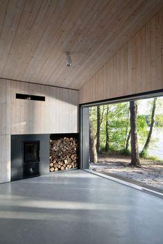 Timber walls and ceiling plus grey polished floor finish? Lake Cabin | FAM Architekti