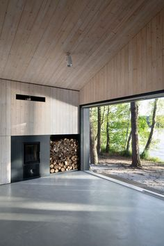 Timber walls and ceiling plus grey polished floor finish? Lake Cabin   FAM Architekti