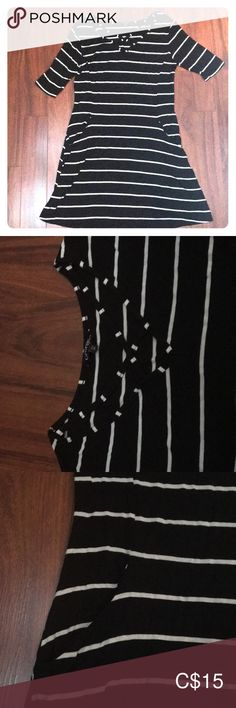 striped dress striped dress with pockets at the front and crossed neckline Almost never worn In very good condition George Dresses Midi Striped Dress, Neckline, Pockets, Black And White, Best Deals, How To Wear, Closet, Things To Sell, Dresses