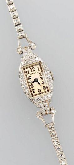HAMILTON Art-Deco wristwatch w/ diamonds, platinum, 84 diamonds total approx. 2.0 ct, manual winding, L. approx. 16-16.5 cm, safety chain (hva)