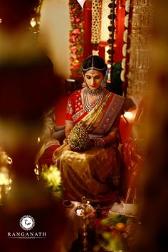 South Indian bride. Gold Indian bridal jewelry.Temple jewelry. Jhumkis. Red and gold silk kanchipuram sari.Braid with fresh jasmine flowers. Tamil bride. Telugu bride. Kannada bride. Hindu bride. Malayalee bride.Kerala bride.South Indian wedding.