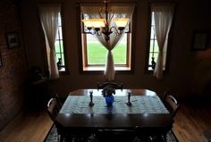 """The dining room in """"The Room of the Future,"""" in the original brick portion of the Harshbarger home."""
