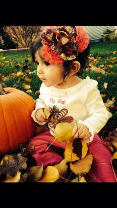 My babies first thanksgiving photo:)outfit from Babies R Us, and I homemade the headband:)