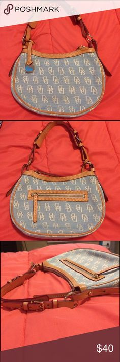 Dooney &Bourke signature canvas & leather shoulder Blue and white signature hobo with tan leather zippers and straps. Designers hang tag on front. Audio and a zip pocket inside.  Really classic bag for all seasons. Excellent condition. Dooney & Bourke Bags