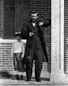 Ulysses S. Grant and his son, Jesse Root, on the porch of their home in Galena, Ill.