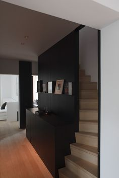 interior | co.studio. Black feature wall. The stair colour is a great contrast.