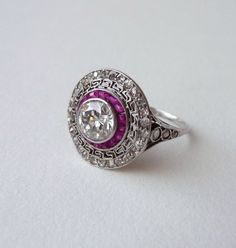 Art Deco Platinum and Diamond Ring with Rubies, 1920's.........