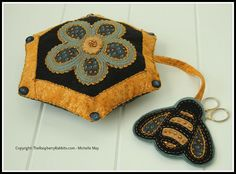 $9 Beekeeper Pincushion - Folk Art Fusion pattern is fast + EZ to make. Holds embroidery scissors! Wool felt + Valdani 3 strand floss kits available at webshop. The Raspberry Rabbits by michelle May from new Bern, NC. Textile folk artist + instructor. Sells patterns, books, etc. at her shop.