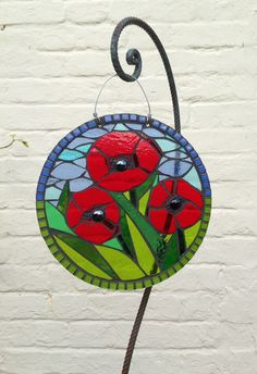 Art for the garden. Glass poppy mosaic. www.primrosemosaics.com
