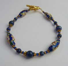 A Beautiful Cloisonne Beaded Bracelet (Highlighted in White, Gold and Pink), with Lapiz Lazuli Beads and Gold Seed Beads - pinned by pin4etsy.com