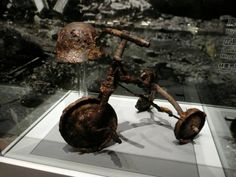 A walk around Hiroshima's Peace Memorial Museum.  A 3-year-old boy was riding this tricycle in front of his house when the bomb hit. He was badly burned and died that night. His father, feeling his son was too young to be buried in a lonely grave away from home, and thinking he could still play with the tricycle, buried his son with the tricycle in his backyard. Forty years later, he dug up the boy's remains to transfer them to the family grave, and donated the tricycle to the museum.